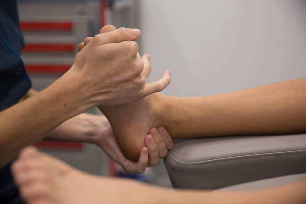 Podiatrist treating common heel pain like plantar fasciitis