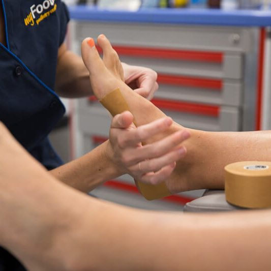 Dancing Stafford Consultations - A podiatrist treating a patient's foot