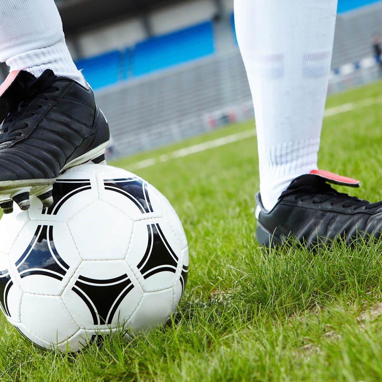 Feet on soccer ball