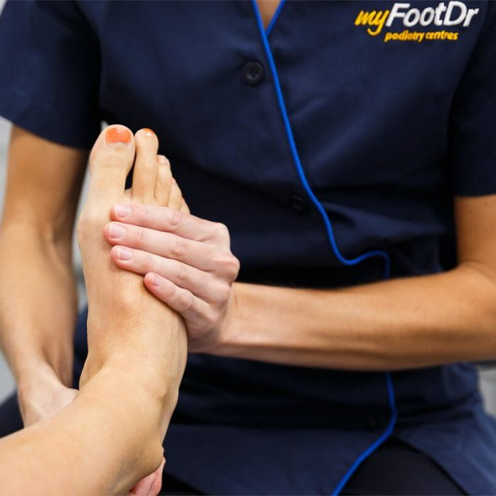 MyFootDr podiatrist treating a patient's foot